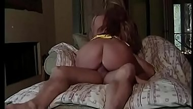 Busty MILF Colt Steele gives head before getting pounded on the sofa