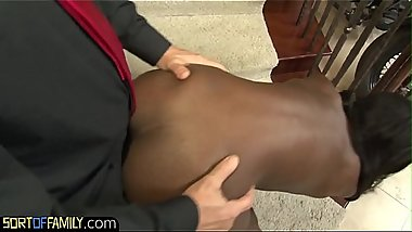 Ebony stepdaughter gobbles down cock