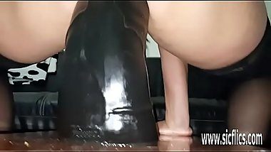 Massive dildos wreck her greedy pussy