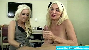 Blonde milfs sucking on the same cock