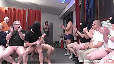 Slutty milf stripper gets covered in cum during a gangbang