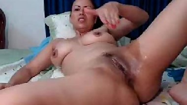 Busty chubby latin milf fucking her pussy with dildo