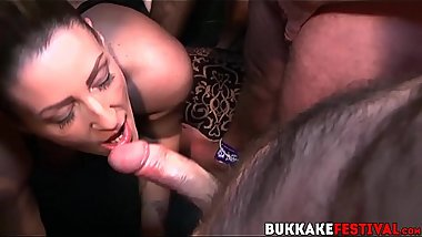 Busty MILFs sucking many dicks at crazy bukkake party