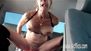 Fucking a gigantic dildo in the back of her car